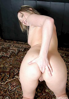 Teenage blonde with shaved pussy
