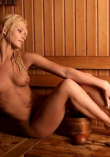sexy blonde posing in sauna